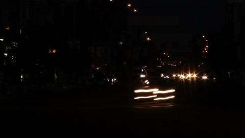 Time lapse of car lights at city crossing, cars leave traces Footage