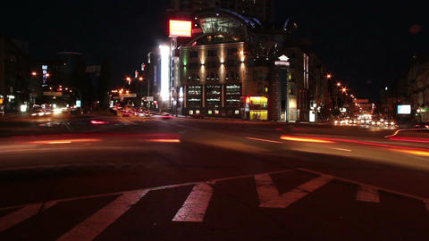 Night time lapse, cars leave light traces, moving on crossroads Footage