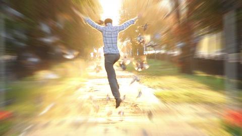 Man jumps high super slow motion shot heaven sun light birds fly Footage