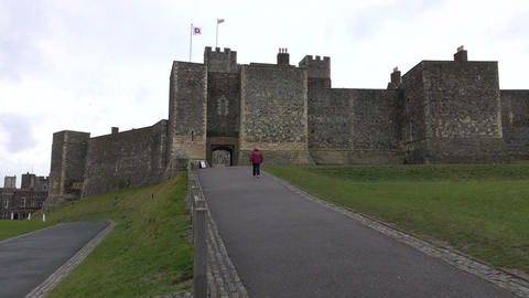 Dover Castle England woman walks to gate entrance 4K Footage
