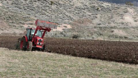 Farm field farmer plowing with heavy duty tractor HD 2467 Footage