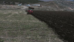 Farm tractor plowing field fast timelapse HD 2475 Footage