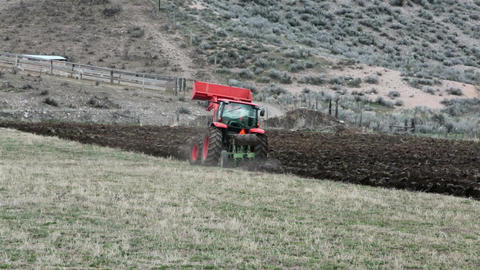 Farm tractor plowing field spring fast motion HD 2458 Footage