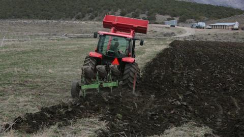 Farmer plowing farm field in spring HD 2487 Footage