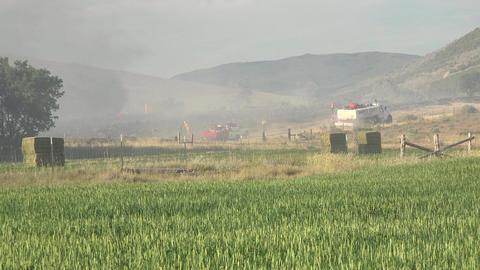 Firefighter crew truck fight wildfire rural farming 4K Footage