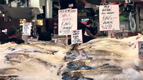 Fresh seafood salmon on ice Seattle fish market HD 6718 Footage