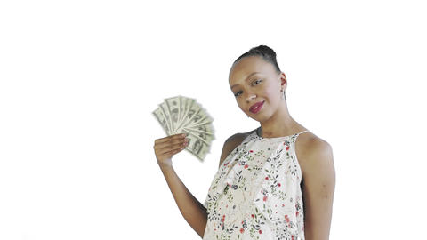 African american woman with money fan on white Background in Studio. White dress Live Action