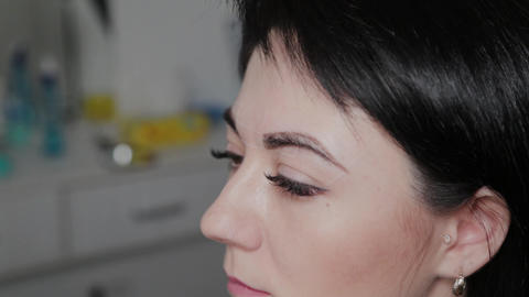 Beautiful woman in a permanent makeup salon with eyebrow markings Live Action