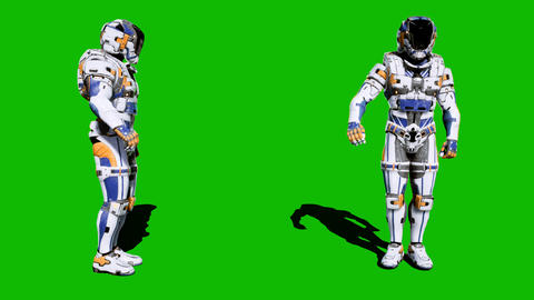 Cosmonaut-soldier of the future salutes in front of the green screen. Looped Animation