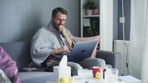 Young man working from home during illness. Online education Live Action