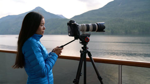 Travel photographer with professional telephoto lens camera in Alaska Live Action