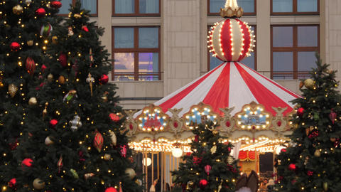 Moscow, Russia. Carousel on Christmas market on beautiful Decorated and illuminated Red Square Live Action