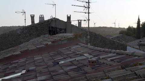 Rooftop view of the old medieval house in the mountain village. Stone house and Live Action