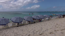 Grand Cayman Island Caribbean sandy beach umbrellas 4K Footage