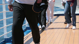 Group of people legs exercise walking cruise ship deck HD 7833 Footage