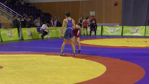 Orenburg, Russia - 28 January 2016: Boys compete in freestyle wrestling Live Action