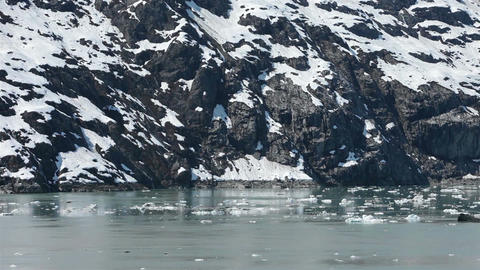 Iceberg rocky mountain shore Glacier Bay Alaska HD 1464 Footage