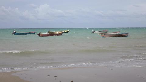 Jamaica beach coastal village fishing boats woman walks 4K Footage