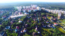 Flying over city village 4k aerial video housing real estate urban landscape Footage