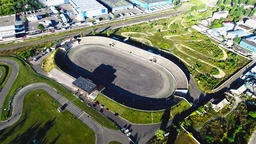Flying over sport road racing track stadium 4k aerial video. Races circuit Footage
