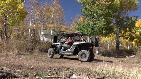 Man drives 4x4 recreation RZR from mountain cabin 4K Footage