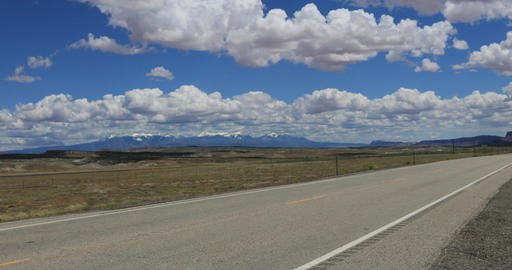 Moab Utah highway traffic Las Sal Mountains DCI 4K Footage
