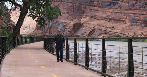 Moab Utah man walking forward Colorado River trail DCI 4K Footage