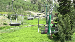 Mother daughter summer chair lift mountains 4K 345 Footage
