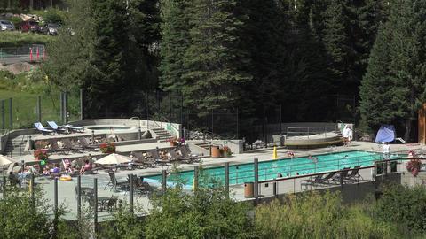 Mountain Luxury Resort swimming pool play 4K Footage