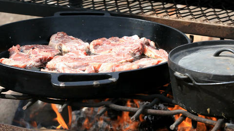 Mutton steaks cooking in cast iron outside P HD 6582 Footage