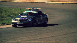 Police car in turn on road race track HD video. Car riding emergency lighting