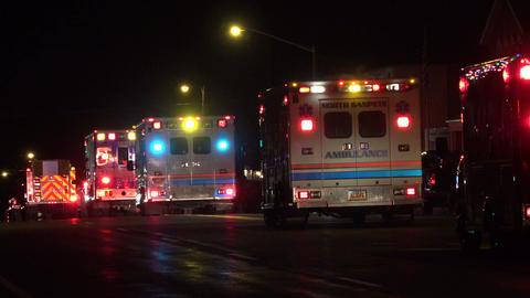 Night winter Christmas light parade ambulance downtown 4K 043 Footage