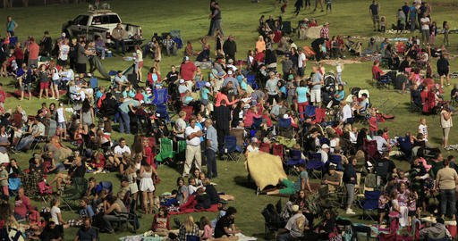Night community celebration crowd in city park night DCI 4K Live Action
