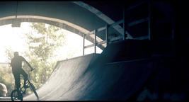 BMX cyclist bicycle riding HD slow motion video. Bike rider in park ramp Footage