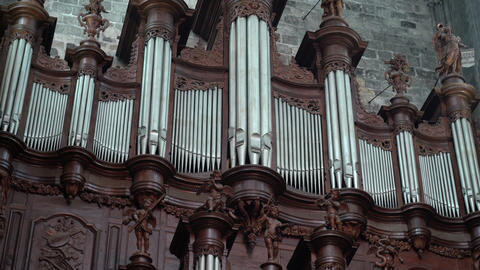 Antique carved wood organ in a catholic temple. Beautiful wood carving. Antiques Live Action