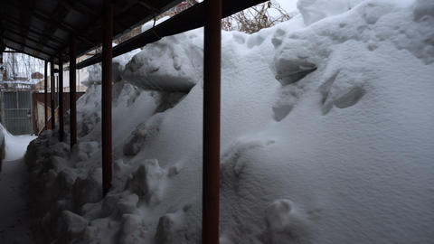 The snow came down from the roof. A large snowdrift above roof Live Action