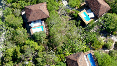 Aerial view of luxury villa with swimming pool in tropical forest, Praia do Live Action