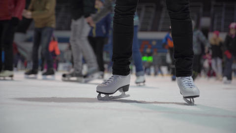 Detail of skates on ice, at the time of skating on public ice Live Action
