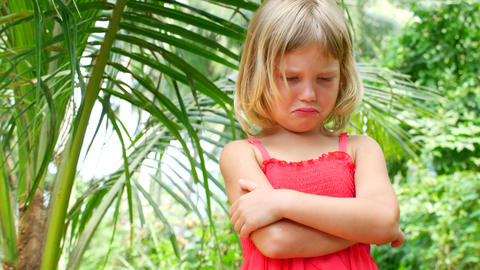 Child is upset and not happy, a girl with arms crossed and an angry face Live Action