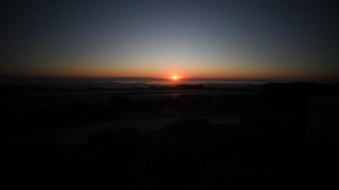 the sun sets far beyond the horizon Live Action