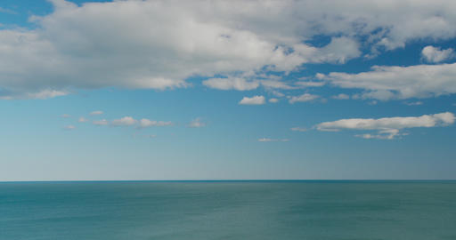Sea view on the nice summer day, clean blue water and smooth waves, blue sky Live Action