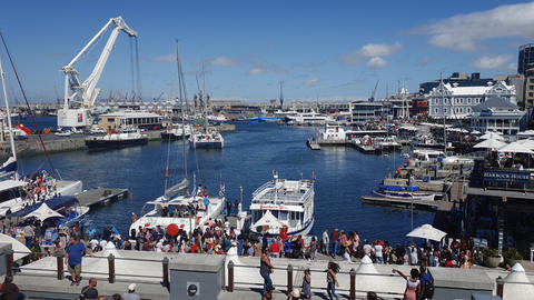 Cape Town, South Africa moored cruise boats with tourists along the Victoria & Alfred waterfront Live Action