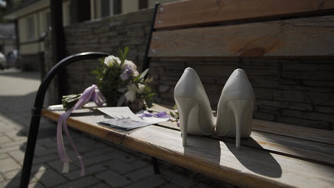 Beautiful women's wedding accessories on a bench. Wedding day Live Action