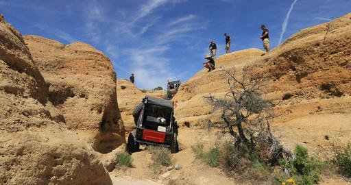 Off road 4x4 red jeep climb steep dangerous mountain fast DCI 4K Footage