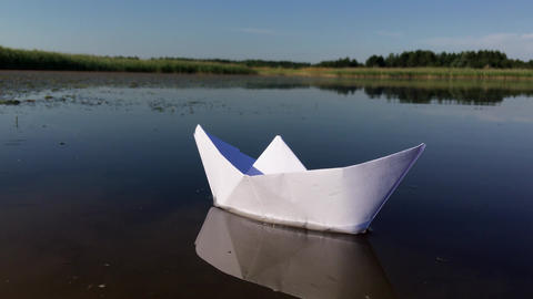 Boat made of paper floating on the river Footage