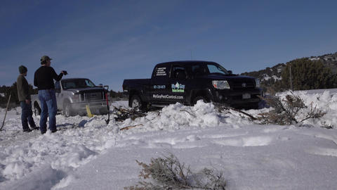 Pulling truck out of winter snow 4K Footage