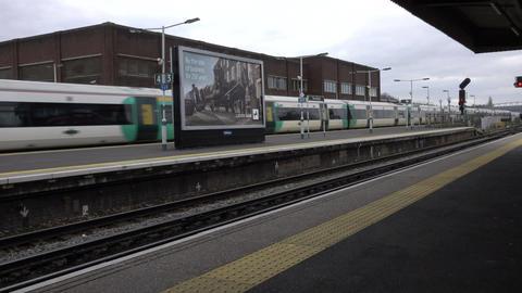 Railroad passenger trains passing at station 4K Footage