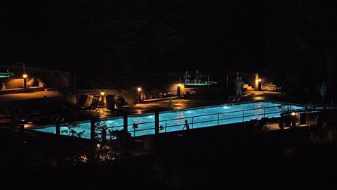 Resort swimming pool play dark night 4K Footage