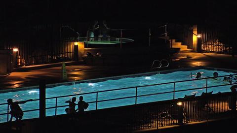 Resort night Silhouette swimming pool play dark 4K Footage