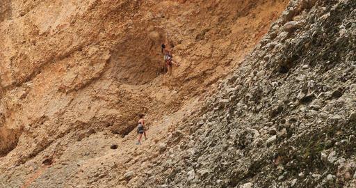 Rock climbing women on steep mountain cliff DCI 4K Footage